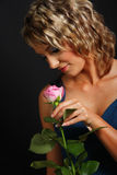 Beautiful girl smelling roses Royalty Free Stock Images