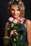 Beautiful girl smelling roses Royalty Free Stock Image
