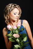 Beautiful girl smelling roses Royalty Free Stock Photography