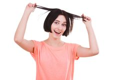 Girl pulls hair with hands in different directions on white isolated background Royalty Free Stock Photography