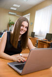 Beautiful girl smiles with laptop Stock Image