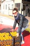 22.10.2016 Turkey, Istanbul - Girl picks up a box of oranges stock photos