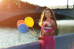 Beautiful girl smiles at sunse stock photos