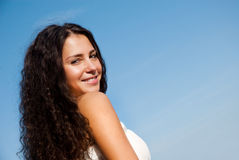 Beautiful girl smiling. Against the sky Royalty Free Stock Image