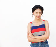 Beautiful girl smiling with arms crossed against white background Stock Images