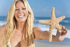 Beautiful Girl Smiling on Beach With Starfish Royalty Free Stock Photo