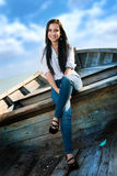 Beautiful girl smiling in the boat. On a sunny day Stock Photography