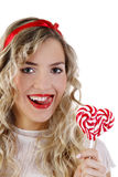 Beautiful girl smiling with a candy Royalty Free Stock Photo