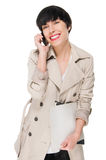 Beautiful girl smiling while using cellphone Royalty Free Stock Photography