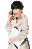 Beautiful girl smiling while using cellphone Royalty Free Stock Photos