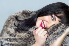 Beautiful girl smiling. Beautiful girl in a fur coat smiling Stock Image