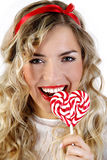 Beautiful girl smiling with a heart candy Stock Image