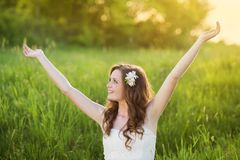 Beautiful girl smiling at the meadow Royalty Free Stock Image