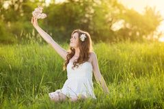 Beautiful girl smiling at the meadow Royalty Free Stock Photo
