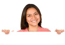 Beautiful girl smiling over white board Royalty Free Stock Image