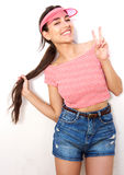 Beautiful girl smiling with peace hand sign Stock Photo