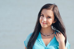 Beautiful girl smiling on the sea Royalty Free Stock Photo
