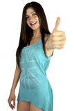 Beautiful girl smiling showing thumb up. Sweet young woman with cute dress showing thumb up smiling Stock Photography