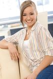 Beautiful girl smiling on sofa Stock Photo