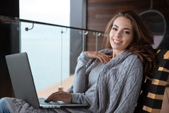 Beautiful girl smiling using laptop Stock Image