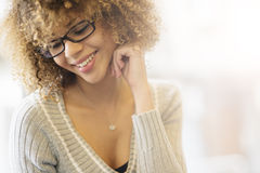 Beautiful girl smiling by the window Royalty Free Stock Images