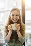 Beautiful girl smiling by the window Stock Photos