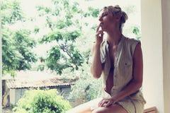 Beautiful girl smokes Stock Photography