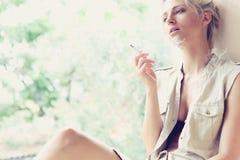 Beautiful girl smokes Stock Photos