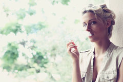 Beautiful girl smokes Stock Images