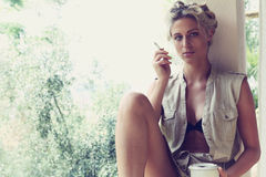 Beautiful girl smokes Stock Image