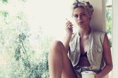 Beautiful girl smokes Royalty Free Stock Photo
