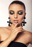 Beautiful girl with smokey eyes makeup and bijou Stock Image