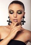 Beautiful girl with smokey eyes makeup and bijou. Studio fashion portrait of beautiful glamour model with dark hair with smokey eyes makeup and bijou Stock Image