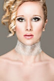 Beautiful girl with smokey eyes. Retouched Stock Photography