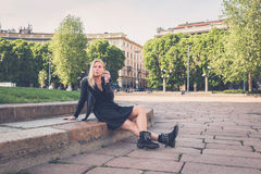 Beautiful girl smoking in the city streets Stock Photo