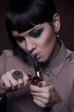 Beautiful girl smoking pipe Stock Photo