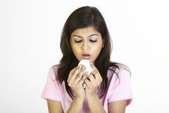 Beautiful girl with sneeze