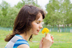 Beautiful girl sniff dandelion Stock Photography