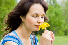 Beautiful girl sniff the flowers Stock Photos