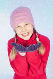 Beautiful girl with snow in hands, blue background Royalty Free Stock Photo