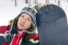 Beautiful girl snowboarder Stock Photos