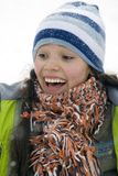 Beautiful girl snowborder. Laughing beautiful girl snowborder in winter Stock Photo