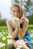 Beautiful girl with snowdrop bouquet in forest Royalty Free Stock Image