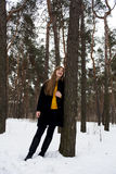 Beautiful girl in a snowy forest. Blonde with long hair. Smiling little. Beautiful girl in a snowy forest. Blonde with long hair. Smiling Stock Image