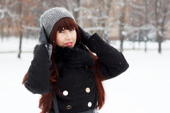 Beautiful girl in a snowy winter park Royalty Free Stock Photo