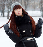 Beautiful girl in a snowy winter park Stock Photo