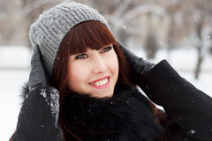 Beautiful girl in a snowy winter park Stock Image