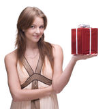 Beautiful girl with some gifts. Beautiful woman with clear makeup and gifts box Stock Image