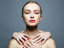 Beautiful girl with someone else`s hands on her neck royalty free stock photo