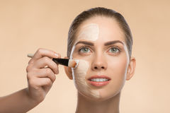 Beautiful girl in spa applying facial cosmetic Stock Photo